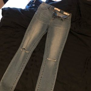 Ripped knee blue jeans